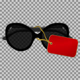 Μαύρα γυαλιά ηλίου με την ετικέτα σε ένα διαφανές υπόβαθρο Στοκ Φωτογραφίες