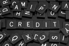 Μαύρα κεραμίδια επιστολών που συλλαβίζουν τη λέξη & x22 credit& x22  στοκ φωτογραφία με δικαίωμα ελεύθερης χρήσης