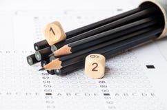 Μαύρα μολύβια και αριθμός στο φύλλο απάντησης Στοκ φωτογραφίες με δικαίωμα ελεύθερης χρήσης