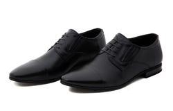 Μαύρα παπούτσια ατόμων δέρματος διπλωμάτων ευρεσιτεχνίας που απομονώνονται στο λευκό Στοκ Εικόνα