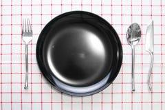 μαύρα πιάτο μαχαιριών και κουτάλι δικράνων Στοκ Φωτογραφία