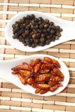 Μαύρα πιπέρι και τσίλι Στοκ Φωτογραφίες
