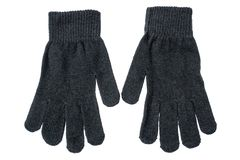 Μαύρα πλεκτά γάντια σε ένα άσπρο υπόβαθρο στοκ φωτογραφίες