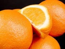 μαύρα πορτοκάλια ανασκόπη& Στοκ Φωτογραφία