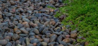 Μαύρα σύσταση και υπόβαθρο πετρών Στοκ φωτογραφία με δικαίωμα ελεύθερης χρήσης