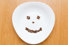 Μαύρα φασόλια καφέ χαμόγελου διασκέδασης Στοκ φωτογραφία με δικαίωμα ελεύθερης χρήσης