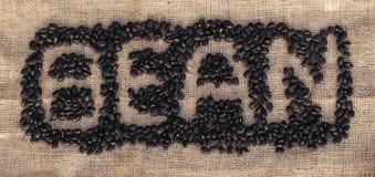 Μαύρα φασόλια που διαμορφώνουν το φασόλι λέξης Στοκ Εικόνα