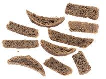 Μαύρα Crumbs ψωμιού που απομονώνονται Στοκ Εικόνες