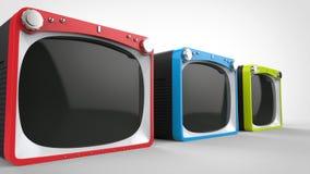 Μαύρες αναδρομικές συσκευές τηλεόρασης με τα κόκκινα, μπλε και πράσινα μέτωπα απεικόνιση αποθεμάτων