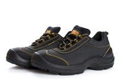 Μαύρες λειτουργώντας μπότες με το κίτρινο νήμα στο λευκό Στοκ Εικόνα