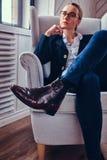 Μαύρες μπότες γυναικών δέρματος Στοκ Φωτογραφίες