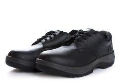 Μαύρες μπότες εργασίας στο άσπρο υπόβαθρο Στοκ Φωτογραφία