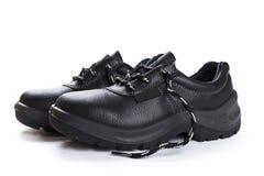 Μαύρες μπότες εργασίας στο άσπρο υπόβαθρο Στοκ φωτογραφία με δικαίωμα ελεύθερης χρήσης