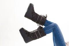 Μαύρες μπότες χειμερινών φεγγαριών διασκέδασης Στοκ Φωτογραφίες