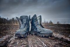 Μαύρες παλαιές μπότες στρατού Στοκ Φωτογραφίες