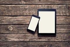Μαύρες συσκευές της Apple - Iphone 6 συν και αέρας Ipad Στοκ Φωτογραφίες