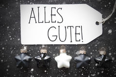 Μαύρες σφαίρες Χριστουγέννων, Snowflakes, καλύτερες ευχές μέσων Alles Gute Στοκ φωτογραφία με δικαίωμα ελεύθερης χρήσης