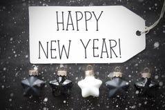 Μαύρες σφαίρες Χριστουγέννων, Snowflakes, κείμενο καλή χρονιά Στοκ εικόνα με δικαίωμα ελεύθερης χρήσης