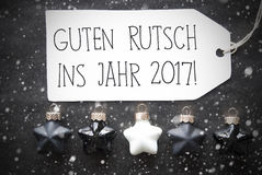 Μαύρες σφαίρες Χριστουγέννων, Snowflakes, Guten Rutsch 2017 νέο έτος μέσων Στοκ Εικόνες