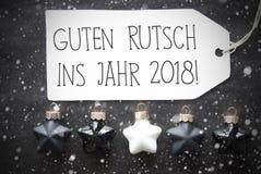Μαύρες σφαίρες Χριστουγέννων, Snowflakes, Guten Rutsch 2018 νέο έτος μέσων Στοκ Φωτογραφίες