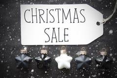 Μαύρες σφαίρες, Snowflakes, πώληση Χριστουγέννων κειμένων Στοκ Εικόνες