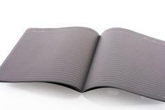 Μαύρη ανοικτή σημείωση βιβλίων Στοκ φωτογραφίες με δικαίωμα ελεύθερης χρήσης