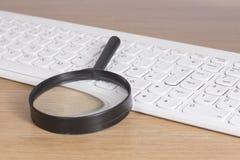 Μαύρη ενίσχυση - γυαλί στο πληκτρολόγιο Στοκ Εικόνες