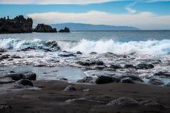 Μαύρη ηφαιστειακή παραλία άμμου χώρων Λα Playa Στοκ Εικόνα