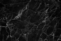 Μαύρη και σκοτεινή μαρμάρινη σύσταση που πυροβολείται κατευθείαν με άσπρο βαθύ Στοκ Εικόνα