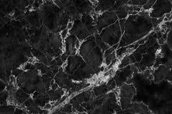 Μαύρη μαρμάρινη σύσταση με τα μέρη αντιπαραβαλλόμενο Στοκ Εικόνα