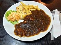Μαύρη μπριζόλα κοτόπουλου πιπεριών Στοκ εικόνες με δικαίωμα ελεύθερης χρήσης