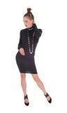 μαύρη μόνιμη γυναίκα φορεμάτ& Στοκ φωτογραφία με δικαίωμα ελεύθερης χρήσης