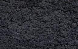 Μαύρη πέτρινη σύσταση τοίχων Στοκ φωτογραφία με δικαίωμα ελεύθερης χρήσης