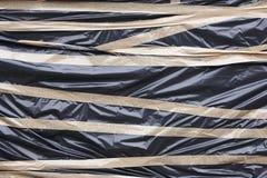 Μαύρη πλαστική προστασία με την κολλητική ταινία Συσκευασία αποθήκευσης Στοκ Εικόνες