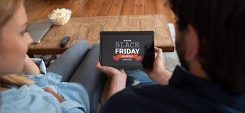 Μαύρη πώληση προώθησης Παρασκευής στην ψηφιακή οθόνη ταμπλετών στοκ εικόνες