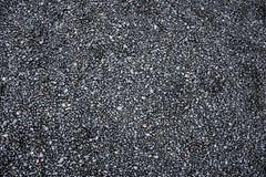 Μαύρη σύσταση παραλιών στοκ φωτογραφία με δικαίωμα ελεύθερης χρήσης