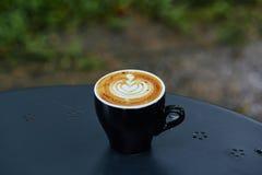 Μαύρη τέχνη φλυτζανιών καφέ latte Στοκ Εικόνες