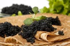 μαύρη τηγανίτα χαβιαριών στοκ εικόνες με δικαίωμα ελεύθερης χρήσης