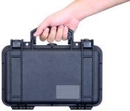 Μαύρη υδατοστεγής βαλίτσα υπό εξέταση Στοκ εικόνα με δικαίωμα ελεύθερης χρήσης