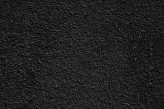 Μαύρη χονδροειδής επιφάνεια του επικονιασμένου σκυροδέματος - σκοτεινό υπόβαθρο στοκ εικόνα με δικαίωμα ελεύθερης χρήσης