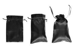 Μαύρη drawstring συσκευασία τσαντών που απομονώνεται Στοκ Εικόνες
