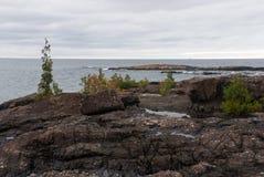 Μαύροι βράχοι του πάρκου νησιών Presque, Marquette, Μίτσιγκαν, ΗΠΑ Στοκ Εικόνες