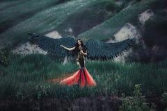 Μαύρος άγγελος Όμορφος κορίτσι-δαίμονας Στοκ φωτογραφία με δικαίωμα ελεύθερης χρήσης