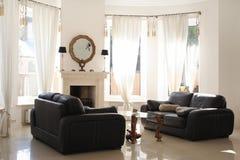 μαύρος καναπές Στοκ Εικόνες