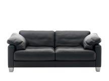 Μαύρος καναπές Στοκ Φωτογραφία