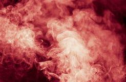 μαύρος κόκκινος καπνός αν&a Στοκ Φωτογραφία