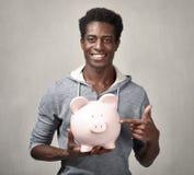Μαύρος με τη piggy τράπεζα στοκ φωτογραφίες με δικαίωμα ελεύθερης χρήσης