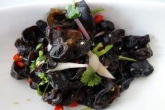 Μαύρος μύκητας στη σάλτσα στοκ φωτογραφία