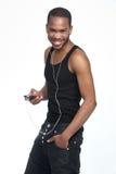 Μαύρος που χαμογελά με τα ακουστικά Στοκ φωτογραφία με δικαίωμα ελεύθερης χρήσης