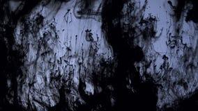 Μαύρος στρόβιλος χρωμάτων αποκριών φόβου φρίκης κινήσεων μελανιού απόθεμα βίντεο